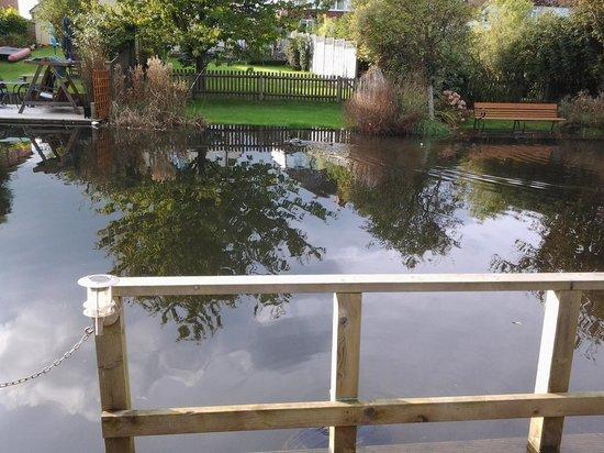 Castle Mill Cottages: the pontoon alongside the garden