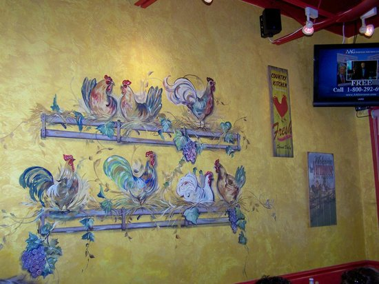 Over Easy Café: Beautiful artwork on the walls..very cheerful.