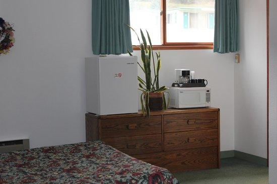 JC Suites: fridge, microwave, coffee maker, storage