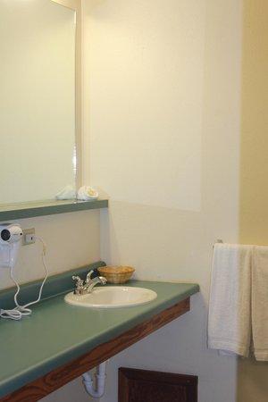 JC Suites: large bathroom, long counter & mirror, good lighting