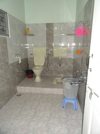 Very neat and clean bathroom...has an attached dressing ...