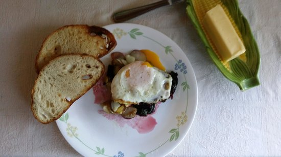 Full House Farm: fresh eggs from the hen house, chard an Potatoe from the garden and bread from the bakery