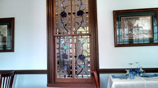 The Blue Rose Inn & Restaurant : Rose Stained Glass Windows Seperate Both Dining Rooms