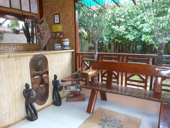 Jungle Flower Guest House: reception with ipel sofa, native designs, bougainvilleas