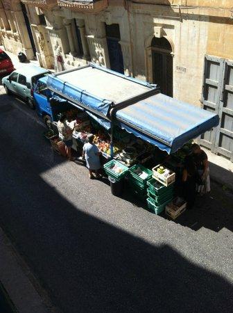 Corner Hostel: Fresh fruit and vegetables outside the hostel.
