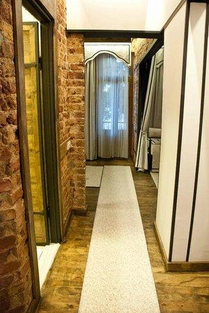 Arx Suites: Red Brick Walls