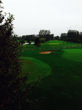 Hilton Belfast Templepatrick Golf & Country Club: The putting green and golf course out our room window...