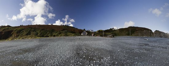 Porthkerris Divers: A panorama of the Porthkerris Dive Centre, looking up the beach. Taken on 12th October 2012.