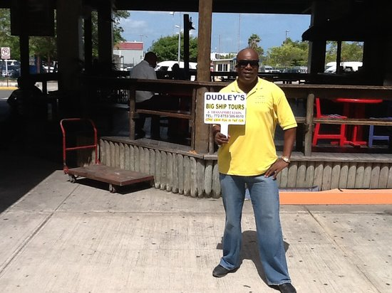 Dudley's Big Ship Taxi and Tours : Dudley with his meet you sign.