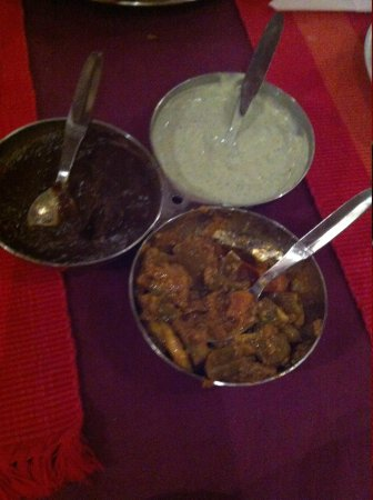 Sajna Restaurant: A small set of entree sauces, eaten with crispy flat bread.