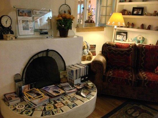 La Posada de Taos B&B: The original fireplace, created in 1983 by local artisan Henry Fresquez