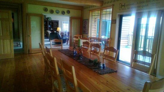 Blue Heron Inn: The dining table in the kitchen, looking into the living room area