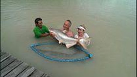 Top Cats Fresh Water Fishing: Happy couple with a catfish