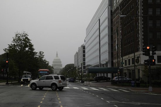 Phoenix Park Hotel: The hotel is on the right looking down through the rain to the Capitol.