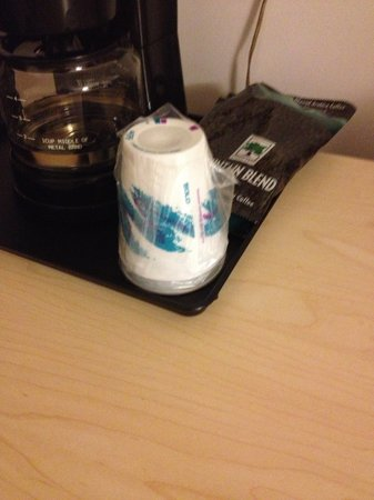 Rodeway Inn : Wasteful Disposable Coffee Cups Wrapped in Plastic