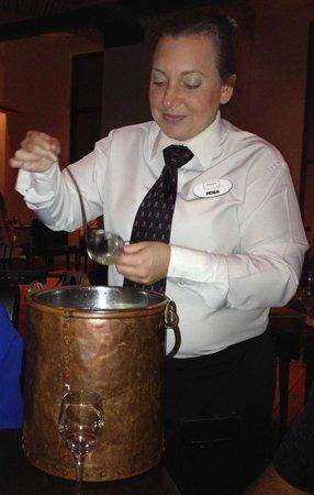 Rosa serving limoncello at Il Mulino, Orlando