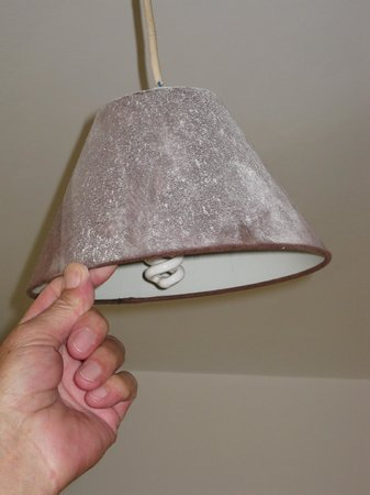 The Sherwood Hotel : Pink? lampshade, complete with dust!