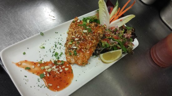 Fuego International Restaurant : cashew and sweet chili crusted char on a bed of citrus micro greens