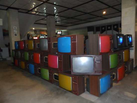 Cosmos Hotel: Reception area made from old TVs