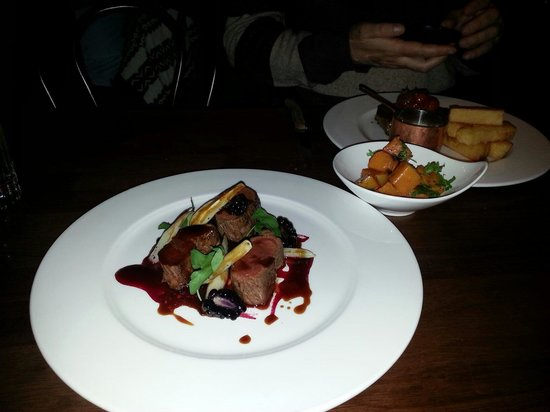 Monteiths: Venison with salsify and bkackberries. Order of pumpkin and a ribeye steak in the background.