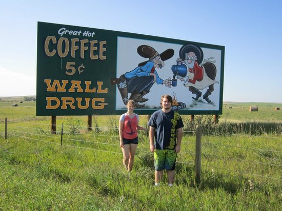 There are many signs telling you to stop at Wall Drug.