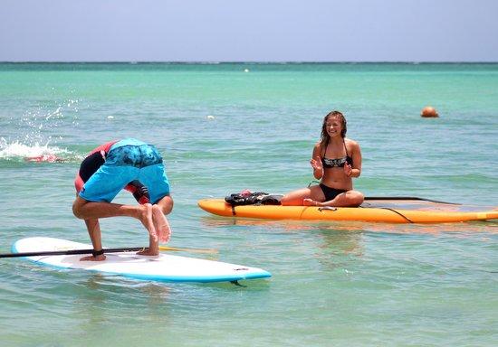 Stand Up Paddle Tobago: Bakasana on a SUP board