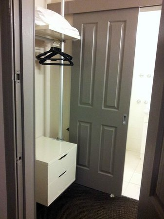 City Square Motel: open closet with extra pillow & blanket