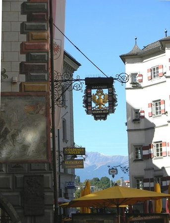 Best Western Plus Hotel Goldener Adler : Hotel Goldener Adler on left with alps in background