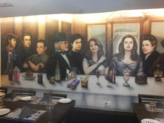 Cafe Royal : Bollywood Hollywood celebrities plastered, on the wall.