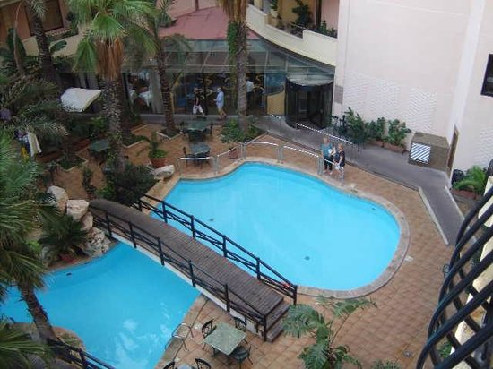 Hotel Fortina: View of part of the garden pool from our balcony
