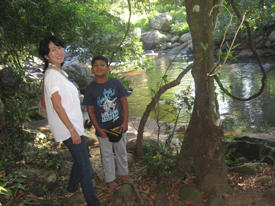 River Garden Resort & Camp Site: my son and my japanies friend near the natural pool  in the hotel