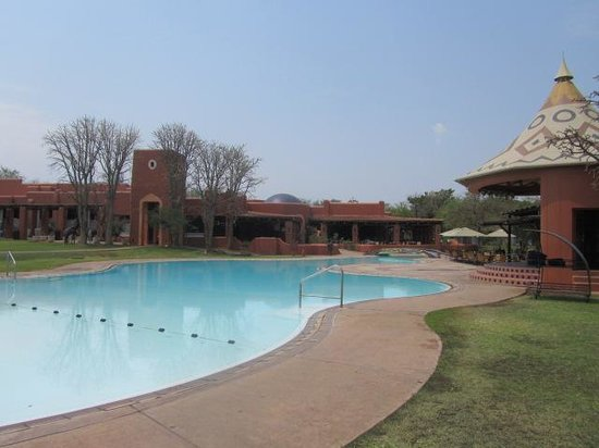 AVANI Victoria Falls Resort: part of the pool and the main dining