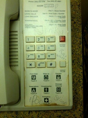 Days Inn Baltimore West Security Blvd: The filthy phone in our room - still had a Doral Inn sticker on it.