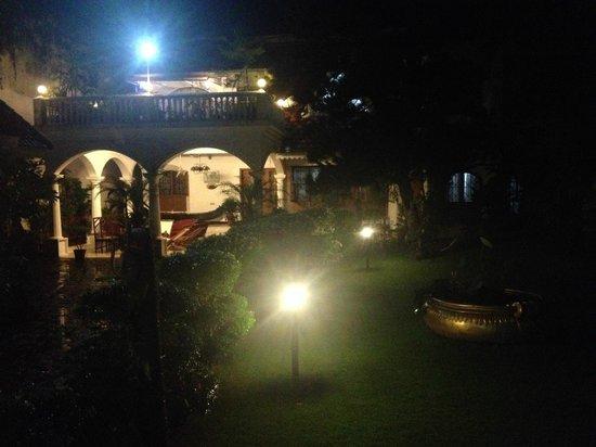 Ann's Residency : Veiw from balcony overlooking reception and garden