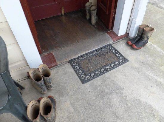 Whangamomona Hotel: Named muddy gumboots are left at the hotel doorstep