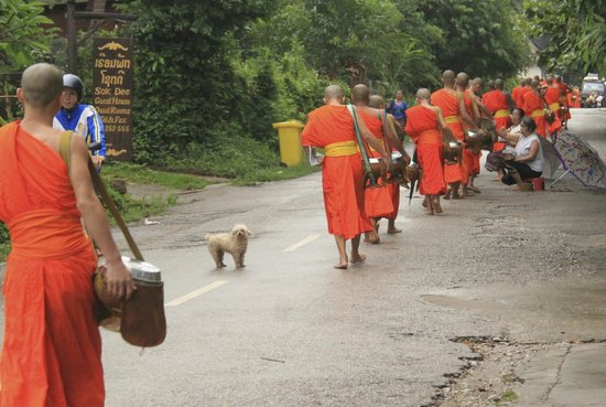 Villa Chitdara: Right outside the hotel, monks walking by for morning alms