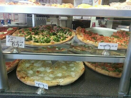 Mario's Pizza and Italian Eatery: Mario and Luigi pizza on the top left, Margarita pizza top right and bianca garlic pizza on the