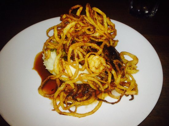 Robin's Restaurant: Flat steak over white carrots and mashed garlic potatoes covered with thin onion rings.