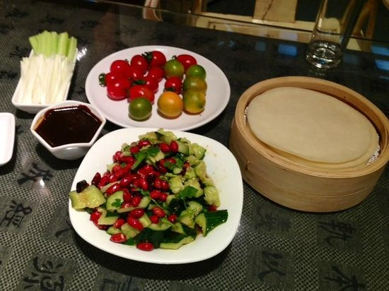 Jingzun Peking Duck Restaurant : side dishes: fresh cherry-tomatoes and pickles
