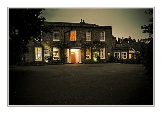 Hadlow Manor Hotel: View by night of the entrance to the Garden Rooms