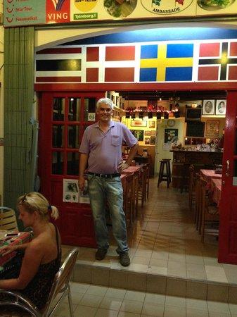 Cafe Europa - Krabi: Henrik - the owner -  at the entrnce
