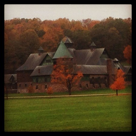 View of Farm Barn at Shelburne Farms surrounded by fall foliage