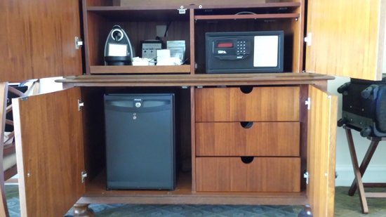 cabinet with tv safe and mini bar picture of mokara hotel and spa san antonio tripadvisor. Black Bedroom Furniture Sets. Home Design Ideas
