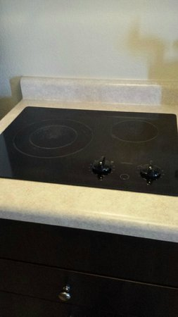 Suburban Extended Stay Hotel: Stove top for cooking.