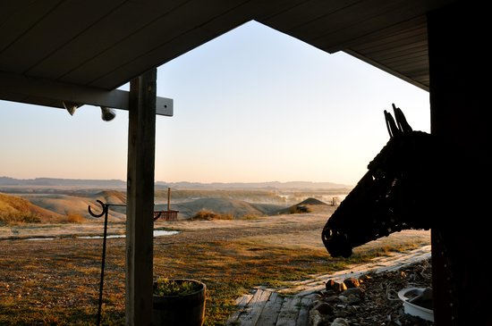 Circle View Guest Ranch: Sculptured horse profiled with the Badlands sunrise in the background.