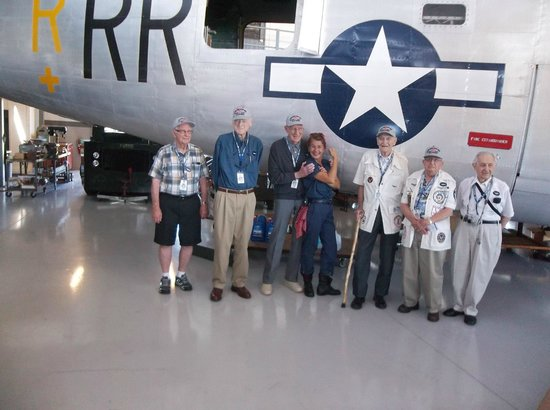 Fantasy of Flight: WW II 22nd Bomb Group vets by B24 with Rosie the Riveter