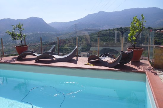 Casa Rossa: the lounge chairs & relaxing pool & of course the view