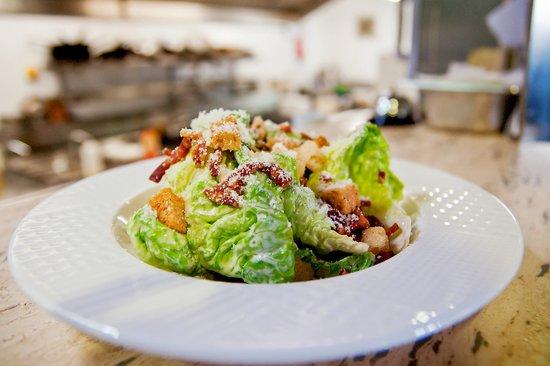 Essence Bistro: Classic Caesar salad, bacon lardons, parmesan & croutons (ac)(n)