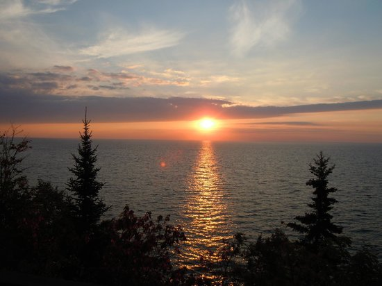 "Cove Point Lodge: Sunrise over Lake Superior from our deck at our Cove ""cottage""."