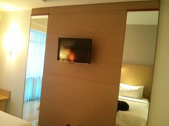 Hotel Santika Premiere Dyandra Medan: The TV is high. Good if you watch it with laying on the bed